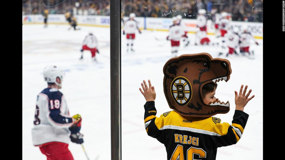 A young fan looks on before a game between the Boston Bruins and the Columbus Blue Jackets in Game Two of the Eastern Conference Second Round during the 2019 NHL Stanley Cup Playoffs at TD Garden in Boston on Saturday, April 27.