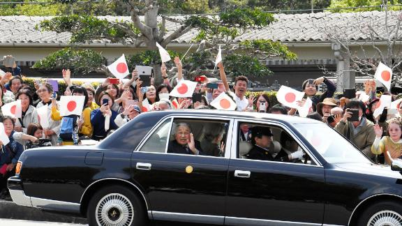 Akihito and Michiko wave to well-wishers in Shima, Japan, in April 2019.