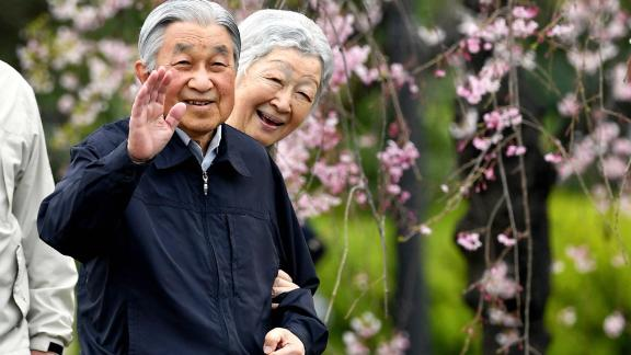 Akihito and Michiko take a brief stroll outside the Imperial Palace in Tokyo in April 2019.