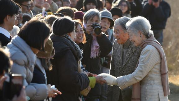 Akihito and Michiko meet well-wishers near the Hayama Imperial Villa.