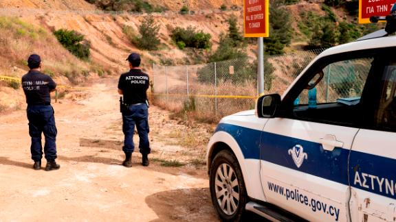 """Cyprus forensic police cordon off a suspected dump site in Red Lake in Mitsero village, southwest of the capital Nicosia on April 26, 2019. - Cypriot authorities were combing lakes for the remains of three women and a girl dumped by a suspected serial killer, in a """"Good Friday"""" hunt for bodies that has shocked the island. (Photo by Iakovos Hatzistavrou / AFP)        (Photo credit should read IAKOVOS HATZISTAVROU/AFP/Getty Images)"""