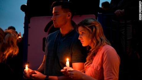 A couple holds candles during a vigil held for victims of the Chabad of Poway synagogue shooting, Sunday, April 28, 2019, in Poway, Calif. A man opened fire Saturday inside the synagogue near San Diego as worshippers celebrated the last day of a major Jewish holiday. (AP Photo/Denis Poroy)