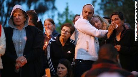 "Community members and congregants attend a candlelight vigil for the victim of the Chabad of Poway Synagogue shooting on April 28, 2019 in Poway, California. - A rabbi who carried on preaching despite being wounded in the latest deadly shooting at a US synagogue said on April 28 that Jews would not be intimidated by the ""senseless hate"" of anti-semitism. (Photo by SANDY HUFFAKER / AFP)        (Photo credit should read SANDY HUFFAKER/AFP/Getty Images)"