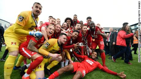 Leyton Orient players celebrate securing promotion to League Two.