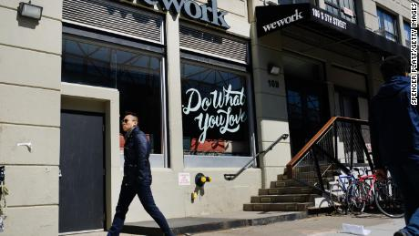 NEW YORK, NEW YORK - MARCH 26: People walk by the co-working space WeWork in the Williamsburg neighborhood in Brooklyn on March 26, 2019 in New York City. WeWork, which lets freelancers and other non-traditional workers to become members in a shared or flexible office space, has expanded globally over the last year but continues to suffer large losses. While in 2018 WeWork saw a more than doubling of its sales to $1.82 billion from a year earlier, the company's losses over that same period also more than doubled to $1.93 billion.  (Photo by Spencer Platt/Getty Images)