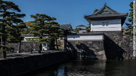 TOKYO, JAPAN - APRIL 09: A woman walks over a walkway leading from Kikyo-mon Gate in the Imperial Palace, on April 9, 2019 in Tokyo, Japan. Tokyo's Imperial Palace was built on the site of the old Edo Castle which began construction in 1457 and is now the primary residence of the Emperor of Japan. The Palace is expected to host a number of events during the abdication of Emperor Akihito, who is stepping down on April 30 due to ill health, and in ceremonies the following day during Prince Naruhitos accession to the Chrysanthemum Throne. (Photo by Carl Court/Getty Images)