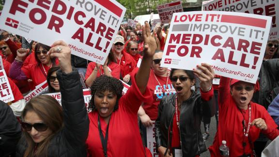 "Protesters supporting ""Medicare for All"" hold a rally outside PhRMA headquarters April 29, 2019 in Washington, DC. The rally was held by the group Progressive Democrats of America."