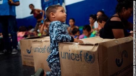 Venezuelan refugees waiting for UNICEF humanitarian supplies in Colombia in April 2019.
