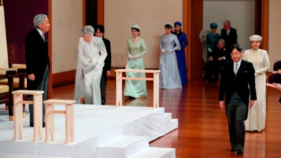 Crown Prince Naruhito walks in front of his father as he arrives for the abdication ceremony.