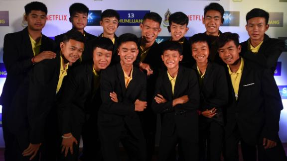 Members of the 'Wild Boars' soccer team posed for a photo alongside their coach during a press conference in Bangkok to announce their deal with Netflix.