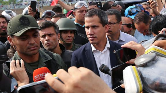 Guaido, center, appears before reporters and photographers outside the airbase in Caracas. To his right is opposition activist Leopoldo Lopez, who is essentially his predecessor.