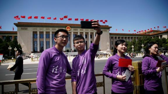 Tsinghua University students take selfies after the conference for the 100th anniversary of May 4th Movement at Great Hall of the People in Beijing.