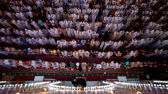 Shiite Muslim worshippers take part in the early morning prayers for Eid al-Fitr after the conclusion of the holy fasting month of Ramadan.