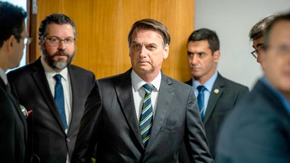 30 April 2019, Brazil, Brasilia: Jair Bolsonaro (M), President of Brazil, comes to meet Foreign Minister Maas. Maas is the first German government member to visit Brazil after the election of right-wing populist Jair Bolsonaro as president. Photo by: Fabian Sommer/picture-alliance/dpa/AP Images