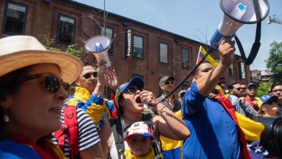 Supporters of Venezuelan opposition leader Juan Guaido hold a rally outside the Venezuelan Embassy in Washington, DC, April 30, 2019. - Activists opposed to supporters of Venezuelan opposition leader Juan Guaido have been staging a round-the-clock vigil inside the Embassy in an effort to prevent representatives of Guaido from taking over the building and keeping it in the hands of Venezuelan Leader Nicolas Maduro. (Photo by SAUL LOEB / AFP)        (Photo credit should read SAUL LOEB/AFP/Getty Images)