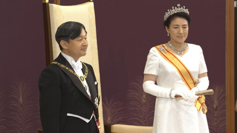 Emperor Naruhito stands with his wife, Empress Masako at a ceremony in the State Hall of Tokyo's Imperial Palace.