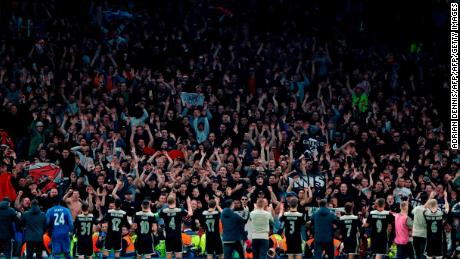 Ajax players celebrate victory in front of their fans.