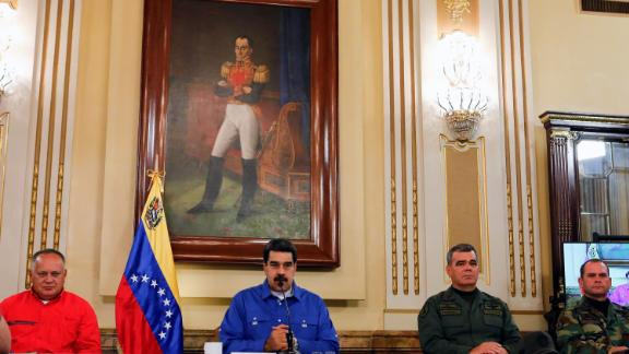 "Maduro, center, gives a live televised address on April 30. ""We have been facing various forms of coup d"