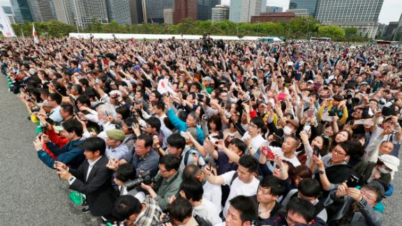 People gather to see the new Emperor leaving the Imperial Palace.