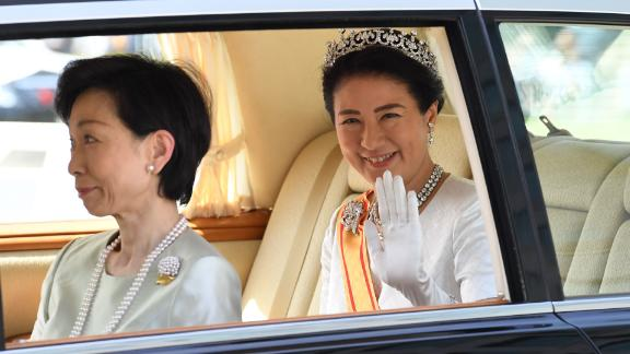 Naruhito's wife, Masako, arrives at the Imperial Palace.