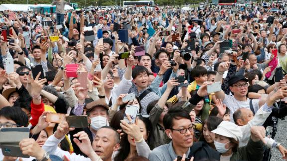 People gather to see the new Emperor and take photos.