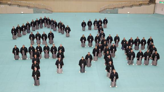 """Sumo wrestlers create the characters for """"Reiwa,"""" Japan's new imperial era, at a Tokyo sports arena."""