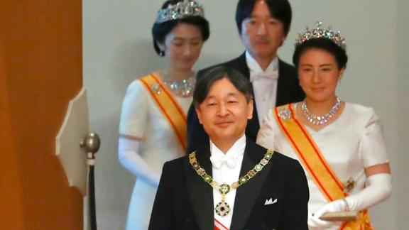 Naruhito is followed by his wife, Masako, as he walks to make his first address as Emperor.