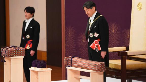 Japan's new Emperor Naruhito, right, attends his coronation ceremony at the Imperial Palace in Tokyo on Wednesday, May 1. Standing at left is his brother, Crown Prince Akishino.