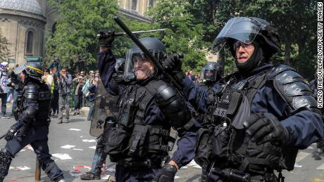 French riot police officers move forward as demonstrators rally in Montparnasse for May Day on Wednesday.