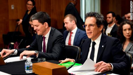 Actor Ben Stiller, front right, and David Miliband, front left, the former British foreign secretary who now leads the International Rescue Committee (IRC), sit down to testify before the Senate Foreign Relations Committee on Capitol Hill in Washington, Wednesday, May 1, 2019, during a hearing on the humanitarian Impact of 8 years of war in Syria. (AP Photo/Susan Walsh)