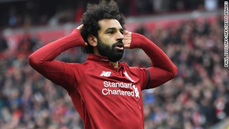 Liverpool's Egyptian midfielder Mohamed Salah celebrates after scoring their second goal during the English Premier League football match between Liverpool and Chelsea at Anfield in Liverpool, north west England on April 14, 2019. (Photo by Paul ELLIS / AFP) / RESTRICTED TO EDITORIAL USE. No use with unauthorized audio, video, data, fixture lists, club/league logos or 'live' services. Online in-match use limited to 120 images. An additional 40 images may be used in extra time. No video emulation. Social media in-match use limited to 120 images. An additional 40 images may be used in extra time. No use in betting publications, games or single club/league/player publications. /         (Photo credit should read PAUL ELLIS/AFP/Getty Images)