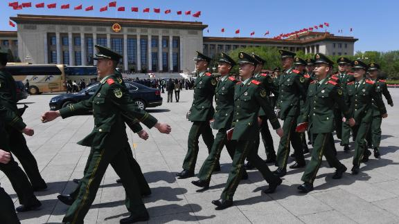 Paramilitary police officers march in Tiananmen Square after a ceremony marking the centennial of the May Fourth Movement on April 30.