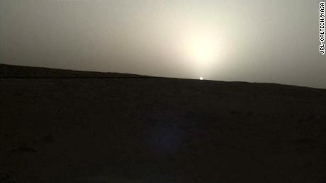 NASA's InSight lander used the Instrument Deployment Camera (IDC) on the end of its robotic arm to image this sunset on Mars on April 25, 2019, the 145th Martian day, or sol, of the mission. This was taken around 6:30 p.m. Mars local time.