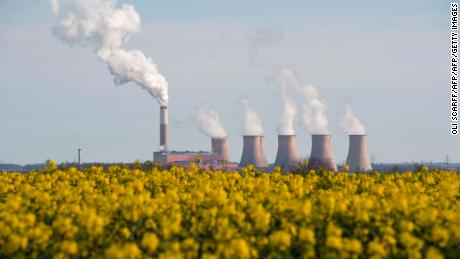 Smoke rises from the cooling towers of Cottam coal-fired power station, in east England, April, 2015.