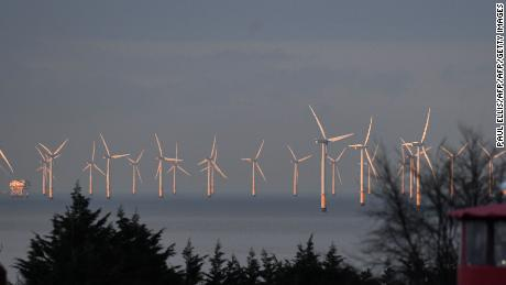 Wind and solar power accounted for 18% of UK electricity generation in 2017. Pictured: Wind turbines stand in the Irish Sea, north Wales, March 2016.