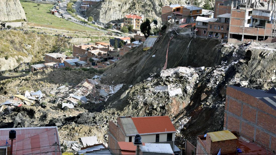 Dramatic footage shows Bolivian landslide sweeping away houses