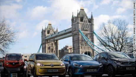 The Committee on Climate Change recommends the UK phase out petrol and diesel cars completely by 2035.   Pictured: Hybrid and electric cars in London, February 23, 2017.