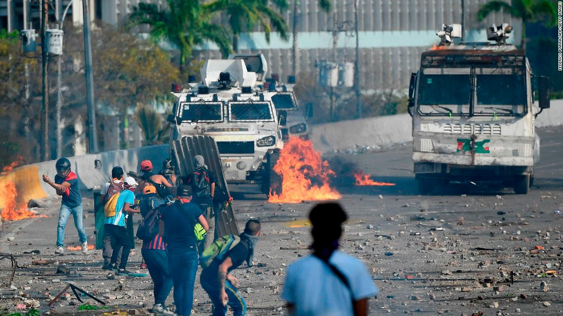 Anti-government protesters clash with security forces during the May Day protests in Caracas.