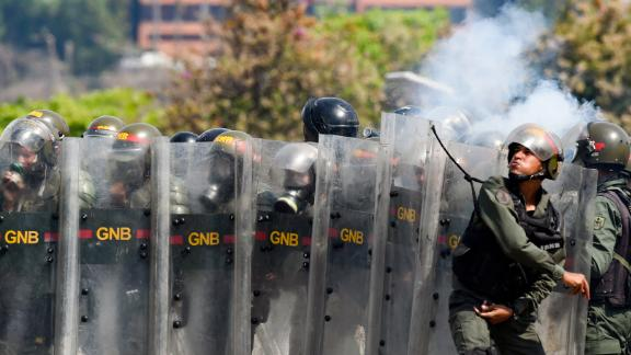 Members of Venezuela's National Guard clash with protesters on May 1.