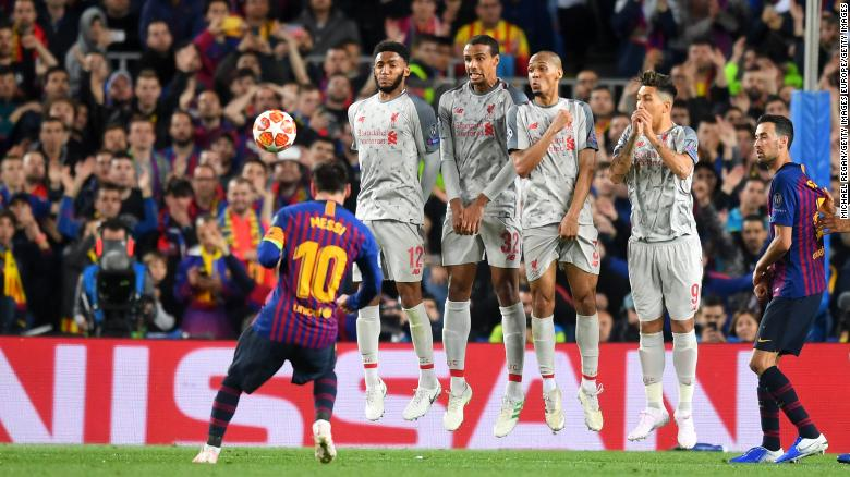 Messi scores his second goal in the 3-0 win over Liverpool.