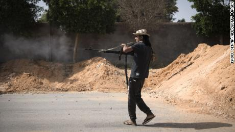 A fighter loyal to the internationally recognised Government of National Accord (GNA) fires his weapon during clashes with forces loyal to strongman Khalifa Haftar south of the capital Tripoli's suburb of Ain Zara, on April 25, 2019.