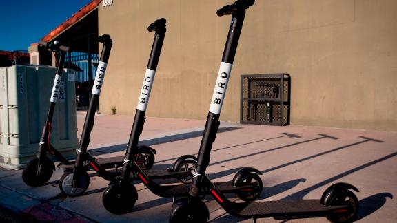 Dockless electric scooters operated by scooter-share company Bird, parked on a sidewalk in San Diego's North Park, in August 2018.