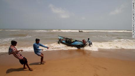 Fishing boats at Konark beach prepare for cyclone Fani in Odisha.