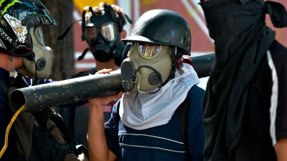 Anti-government protesters prepare to clash with security forces in Caracas.