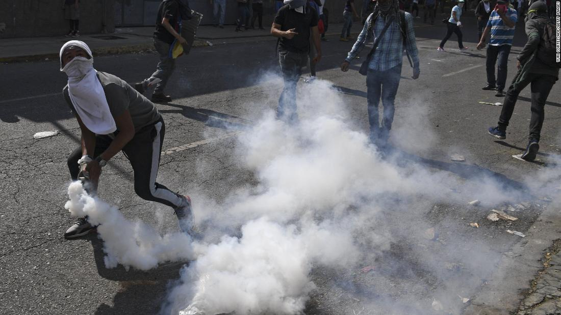 Anti-government protesters clash with security forces on May 1.