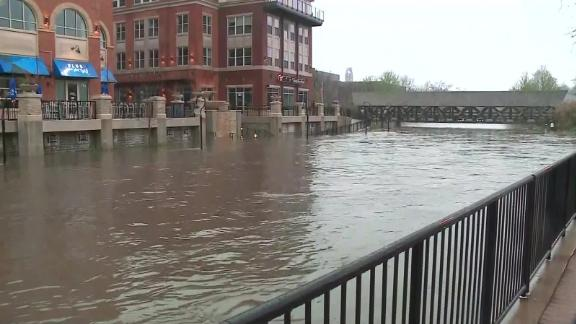 The Naperville riverfront rises after heavy rains.