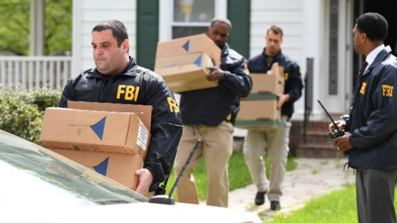 Federal agents in April removing items from the home of then-Baltimore Mayor Catherine Pugh.