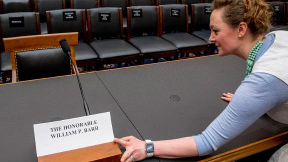 A congressional aide puts out a name placard for Attorney General William Barr who is not expected to appear before a House Judiciary Committee hearing on Capitol Hill in Washington, Thursday, May 2, 2019. The House Judiciary Committee witness chair will be without its witness this morning, Attorney General William Barr, who informed the Democrat-controlled panel he will skip a scheduled hearing on special counsel Robert Mueller's report, escalating an already acrimonious battle between Democrats and the Justice Department. (AP Photo/Andrew Harnik)