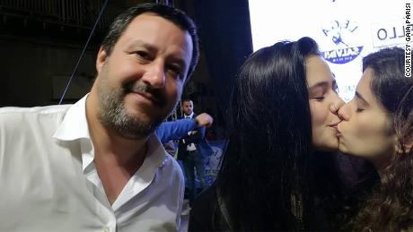 Gaia Parisi and Matilde Rizzo surprise right-wing politician Matteo Salvini with a kiss.