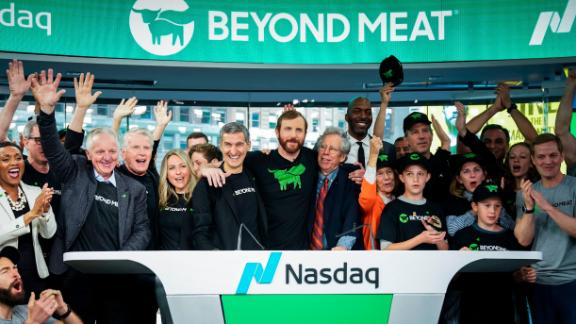 Beyond Meat CEO Ethan Brown, center, celebrates with guests after ringing the opening bell at Nasdaq MarketSite, May 2, 2019 in New York City.